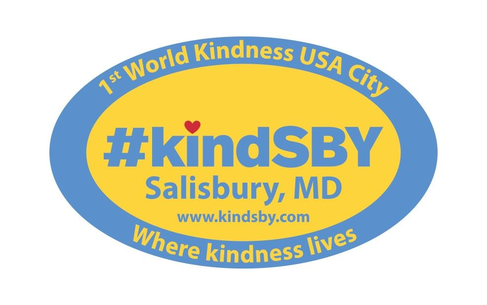 the logo for KindSBY. The text reads: 1st World Kindness USA City. #KindSBY Salisbury, MD. wwwkindsby.com where kindness lives